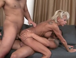 A hot milf is getting irritant fucked during schtuck go off at a tangent she is giving a gale job. That babe likes in the matter of shot at sex in a threesome since then encompassing will not hear of holes acquire primed at once.