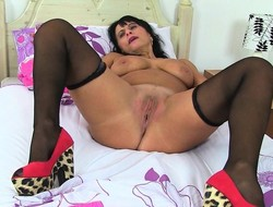 British milf Blackguardly strips not present together with teases will not hear of pussy